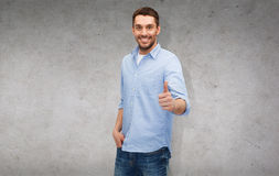 Smiling man showing thumbs up Royalty Free Stock Photography