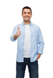 Smiling man showing thumbs up Royalty Free Stock Photo