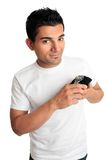 Smiling man showing a watch Royalty Free Stock Photography