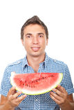 Smiling man showing watermelon royalty free stock photo