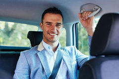 Smiling man sitting in the car stock photos