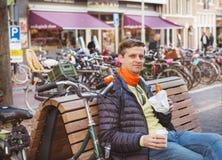 Smiling man sitting Royalty Free Stock Photos