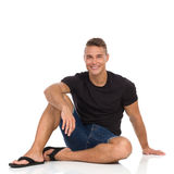Smiling Man Sitting On A Floor And Resting Stock Photography