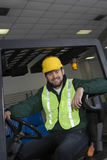 Smiling Man Sitting In Forklift Truck Royalty Free Stock Photos