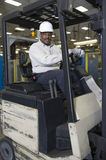 Smiling Man Sitting In Forklift Truck Royalty Free Stock Photo