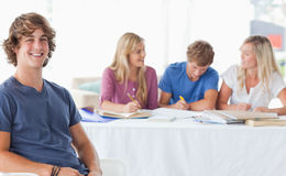 Smiling man sitting on front of his friends Stock Image