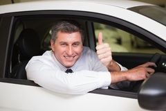 Smiling man sitting in his car giving thumbs up Royalty Free Stock Image