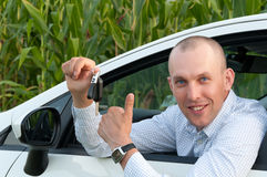 Smiling Man Sitting In The Car Stock Image