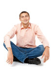 Smiling man sitting in the lotus position Royalty Free Stock Images