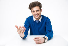 Smiling man sitting at the table Royalty Free Stock Image