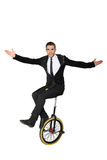 Smiling man sitting on a unicycle. Isolate Royalty Free Stock Images