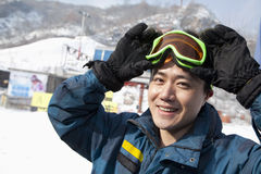 Smiling Man in Ski Resort Royalty Free Stock Photo