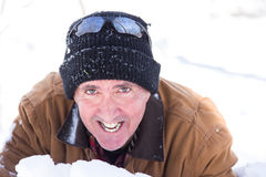 Smiling man in snow Stock Image