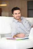 Smiling man on sofa Stock Photo