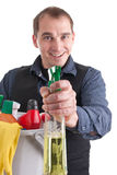 Smiling man with a spray can. Picture of a man with a bucket full of cleaning products and a spray can royalty free stock image