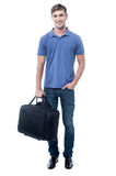 Smiling man standing with bag Royalty Free Stock Image