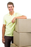 Smiling man standing by boxes Royalty Free Stock Photography