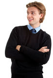 Smiling man standing with crossed arms Royalty Free Stock Image