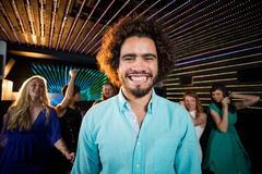 Smiling man standing in dance floor Stock Image