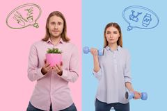 Smiling man standing with a flowerpot while his wife holding hand weights. Healthy lifestyle. Emotional men holding a lovely flowerpot while his strong wife stock photos
