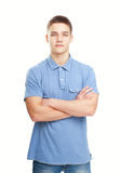 Smiling man standing with hands folded against isolated on white Royalty Free Stock Photo