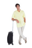 Smiling man standing with his suitcase Royalty Free Stock Photos