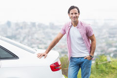 Smiling man standing next to his car Stock Image