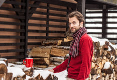 Smiling man standing outdoor - winter countryside landscape Royalty Free Stock Images