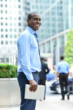 Smiling man standing outside offices building Royalty Free Stock Photo