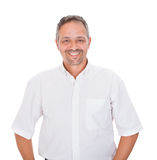 Smiling man standing over white background Royalty Free Stock Images