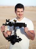 Smiling man with steadicam equipment outdoor Stock Photography