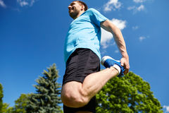 Smiling man stretching outdoors Stock Photography
