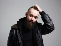 Smiling Man with stylish haircut. handsome Boy with beard royalty free stock photography