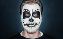 Smiling man with sugar skull makeup Stock Images