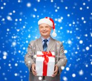 Smiling man in suit and santa helper hat with gift Royalty Free Stock Photography