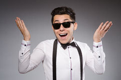 Smiling man in sunglasses against gray Royalty Free Stock Images