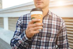 Portrait of stylish young man with cup of coffee. Stock Photos