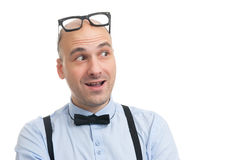 Smiling man with suspenders and bow-tie Stock Images
