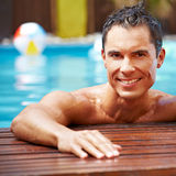 Smiling man in swimming pool Stock Images