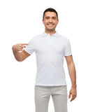 Smiling man in t-shirt pointing finger on himself Royalty Free Stock Photo