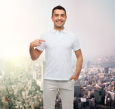 Smiling man in t-shirt pointing finger on himself Stock Photography