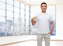 Smiling man in t-shirt pointing finger on himself Royalty Free Stock Photography