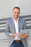 Smiling man with tablet Royalty Free Stock Photography