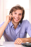 Smiling man talking by cellphone Royalty Free Stock Image