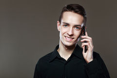 Smiling man talking on the cellphone Royalty Free Stock Photo