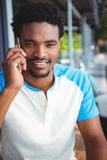 Smiling man talking on the mobile phone Stock Images