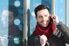 Smiling man talking on phone outdoors Royalty Free Stock Images