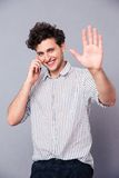 Smiling man talking on the phone Stock Image
