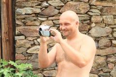 Smiling man taping with camera Stock Photos