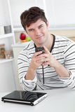 Smiling man texting with his cellphone at home Stock Photography